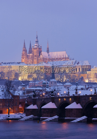 hradcany with charles bridge in winter