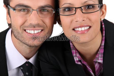smiling man woman wearing pairs of