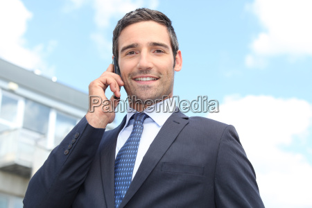 confident salesman stood outside