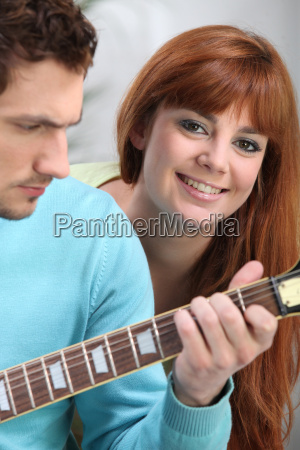 youngster playing the guitar