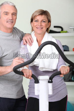 mature couple resting after fitness