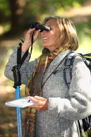 woman in woods orienteering