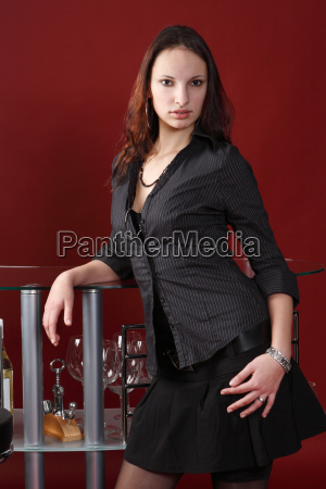 charming woman stands at the bar