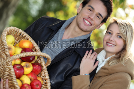 young couple all smiles with basket