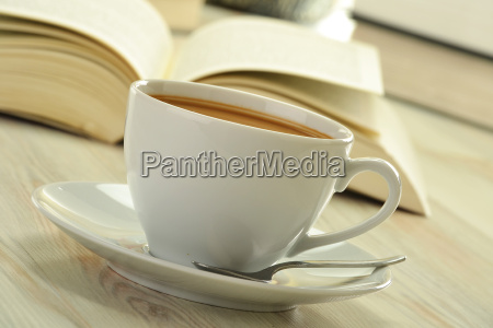 books and cup of coffee on