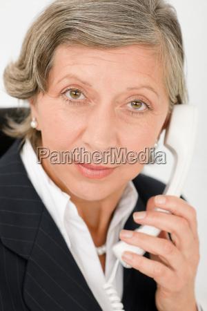 senior businesswoman on phone close up