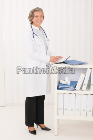 senior doctor female stand in office