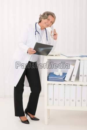 senior doctor female hold x ray