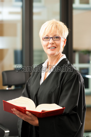 lawyer with law book and robe