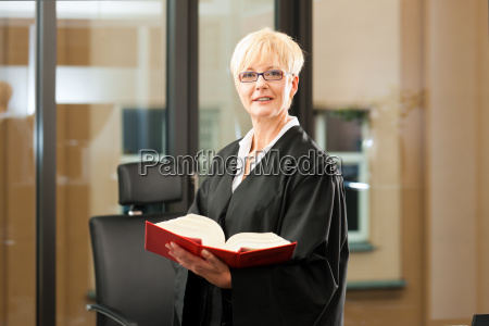lawyer with statute book and robe