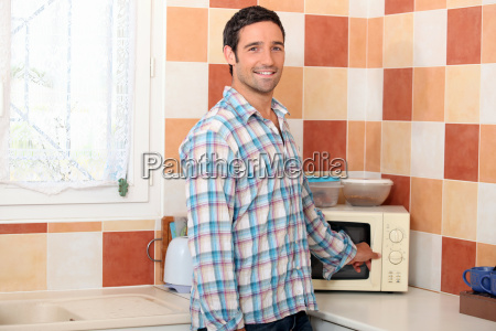 man using the microwave
