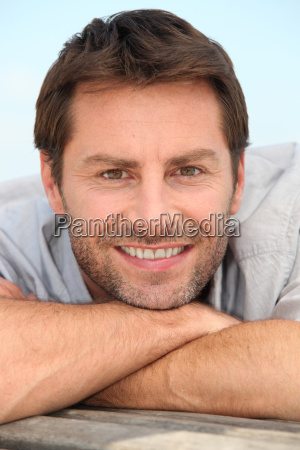 closeup of a smiling man with