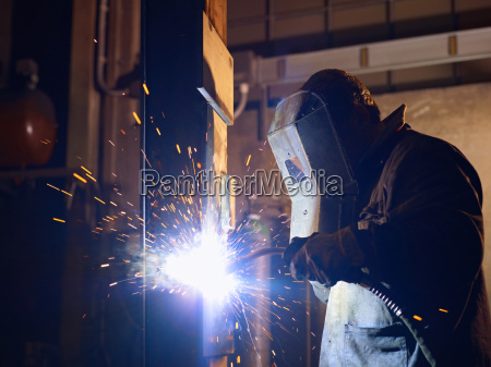 man at work as welder in