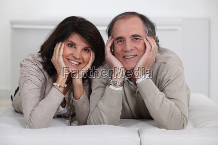 mature couple lying on the couch