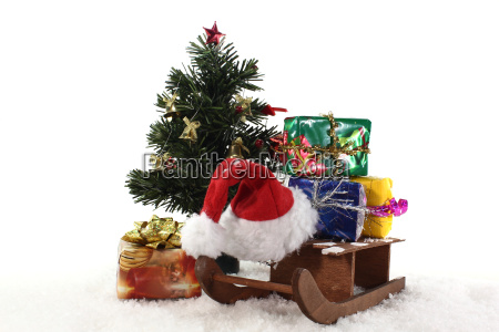 sleigh and gifts under the christmas