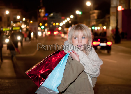 young woman shopping in the evening