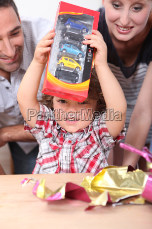 little boy opening birthday present