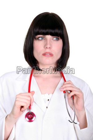 pensive doctor with a stethoscope
