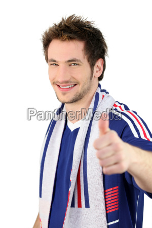 football fan making a thumbs up