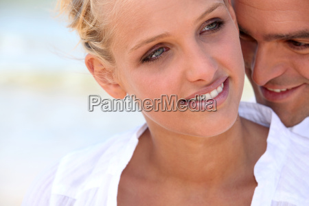 blonde woman hugged tenderly from the
