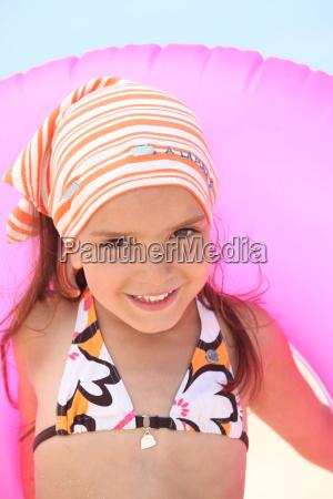young girl in a bikini with