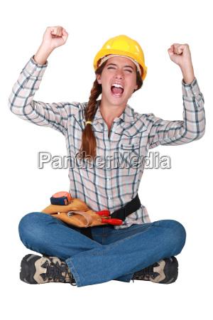 an ecstatic female construction worker
