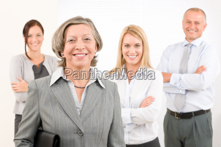 businesswoman senior with colleagues in the