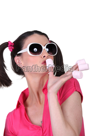 funny woman with marshmallows on the