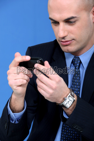 businessman looking at his smartphone
