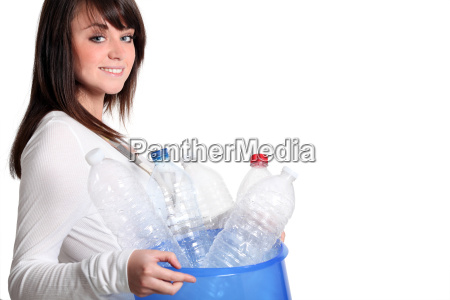 young girl recycling plastic bottles