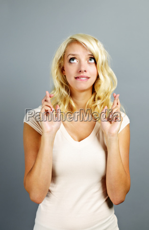 hopeful woman crossing fingers