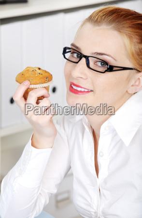 closeup on woman holding a cupcake