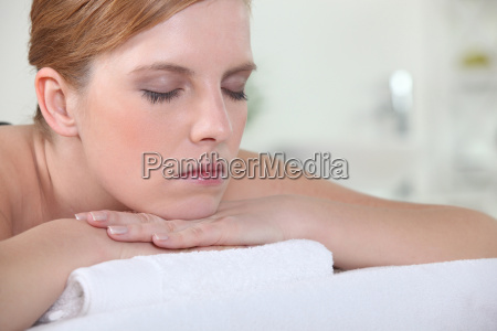 woman with her eyes closed during