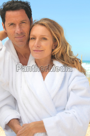 man and woman in toweling robes