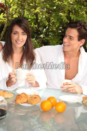 couple having breakfast outside