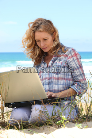 woman working on the beach