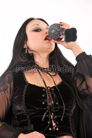 gothic girl drinking from goblet