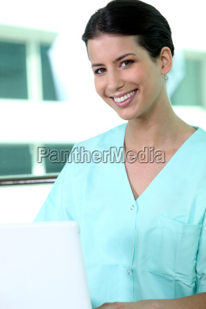 friendly nurse in green scrubs