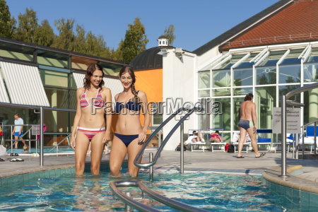 two women at the pool or