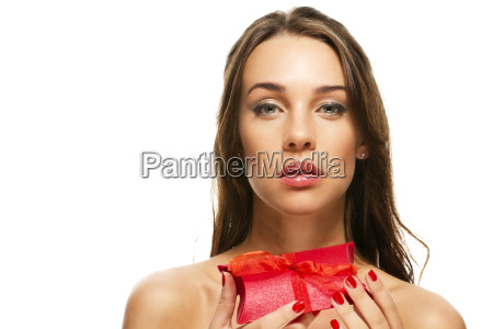 beautiful woman holds red gift