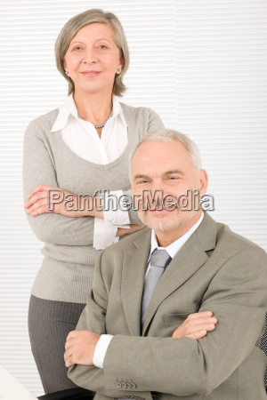 senior businesspeople professional cross arms