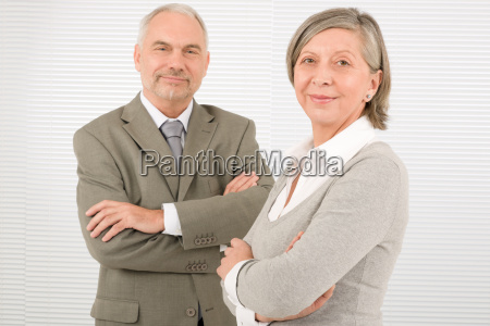 senior businesspeople professional pose cross arms