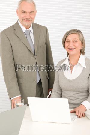 senior happy businesspeople working on computer