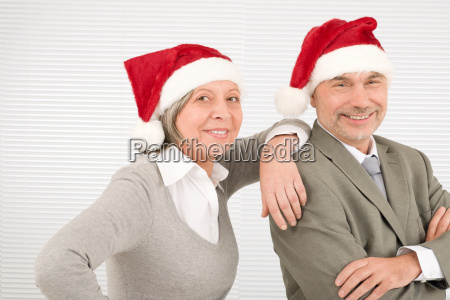 christmas hat senior businesspeople smile together