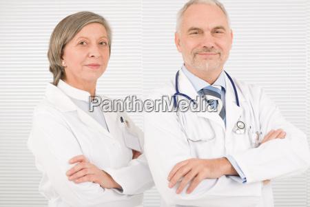 medical team seniors standing cross arms
