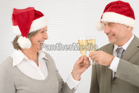 xmas business toast senior colleagues celebrate