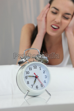 unhappy woman shutting out the noise