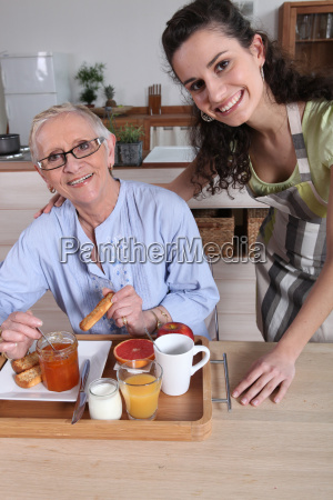 an old woman having breakfast with