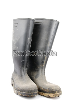 pair of black rubber boots on