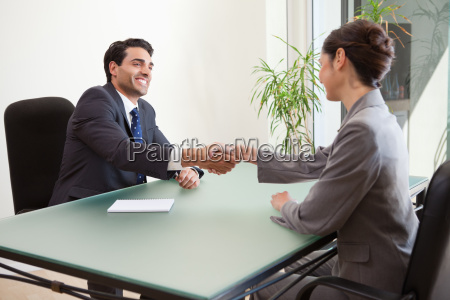 smiling manager interviewing a good looking